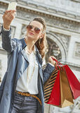 Young woman shopper in Paris, France taking selfie with phone Royalty Free Stock Image