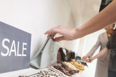 Young woman shopping for accessories at store, close-up Stock Image