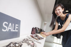 Young woman shopping for accessories at store Royalty Free Stock Image