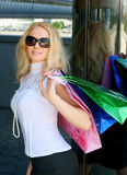 Young woman with shopping bag. And glasses Royalty Free Stock Photos