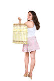 Young woman with shopping bag. Rear view of young woman with shopping bag over shoulder, white studio background Royalty Free Stock Image