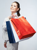Young woman shopping bag hold. Female studio portrait  background Royalty Free Stock Images