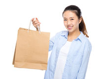Young woman with shopping bag. Isolated on white Stock Photography