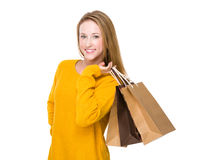 Young woman with shopping bag. Isolated on white background Stock Images