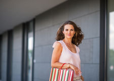 Young woman with shopping bag on the mall alley Stock Images