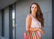 Young woman with shopping bag on the mall alley Royalty Free Stock Image