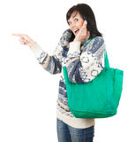 Young woman with shopping bag pointing Royalty Free Stock Image