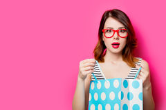 Young woman with shopping bag. Portrait of beautiful young woman with shopping bag on the wonderful pink studio background Stock Photography
