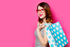 Young woman with shopping bag. Portrait of beautiful young woman with shopping bag on the wonderful pink studio background Stock Photos