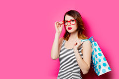 Young woman with shopping bag. Portrait of beautiful young woman with shopping bag on the wonderful pink studio background Royalty Free Stock Image