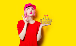 Young woman with shopping bag. Portrait of beautiful young woman with shopping bag on the wonderful yellow studio background Royalty Free Stock Photography