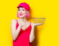 Young woman with shopping bag. Portrait of beautiful young woman with shopping bag on the wonderful yellow studio background Stock Photos