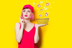 Young woman with shopping bag. Portrait of beautiful young woman with shopping bag on the wonderful yellow studio background Royalty Free Stock Photo