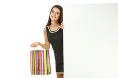 Young woman with shopping bag. Portrait of young woman with shopping bag on white background Royalty Free Stock Photography