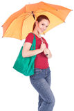 Young woman with shopping bag and umbrella Stock Image