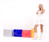 Young woman with shopping bags. Amazed young woman standing near  shopping bags Stock Photos