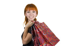 Young woman with a shopping bags. Young woman wish shopping bags isolated on white background Royalty Free Stock Photo