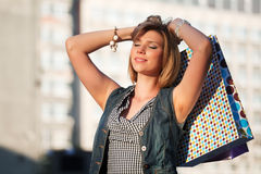 Young woman with shopping bags. Royalty Free Stock Photos