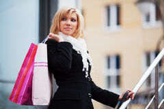 Happy young fashion woman with shopping bags Royalty Free Stock Images
