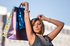 Happy young fashion woman with shopping bags Royalty Free Stock Photo