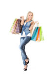 Young woman with shopping bags. Happy young woman holding shopping bags over white background Stock Images