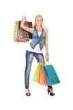 Young woman with shopping bags. Happy young woman holding shopping bags over white background Royalty Free Stock Photos