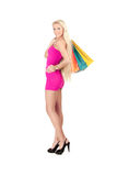 Young woman with shopping bags. Happy young woman holding shopping bags over white background Royalty Free Stock Photo