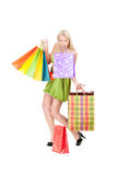 Young woman with shopping bags. Attractive young woman with shopping bags in her hands and teeth losing one Royalty Free Stock Photo