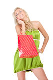 Young woman with shopping bags. Happy young woman with shopping bags talking on cell phone over white background Stock Photography