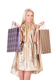 Young woman with shopping bags. Happy young woman holding shopping bags over white background Royalty Free Stock Image