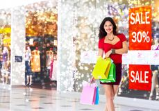 Young woman with shopping bags. Stock Photo