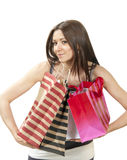 Young woman with shopping bags buying present Stock Images