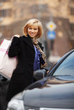 Young woman with shopping bags at the car Royalty Free Stock Photography