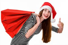 Young woman with shopping bags on Christmas Stock Images