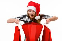 Young woman with shopping bags on Christmas Stock Photos