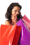 Young woman with shopping bags close-up. Young woman with shopping bags standing close-up on white background royalty free stock photo