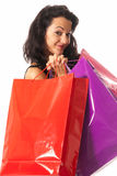 Young woman with shopping bags close-up. Young woman with shopping bags standing close-up on white background royalty free stock images