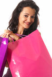 Young woman with shopping bags close-up. Young woman with shopping bags standing close-up  on white background Stock Photo