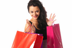 Young woman with shopping bags close-up isolated on white background Stock Photo