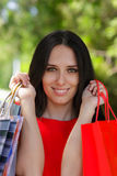 Young Woman with Shopping Bags Close-Up Royalty Free Stock Image
