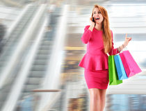 Young woman with shopping bags in commercial center Stock Image
