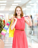 Young woman with shopping bags and credit card Stock Images