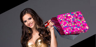 Young woman with shopping bags and credit card on Royalty Free Stock Photos