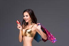 Young woman with shopping bags and credit card on Royalty Free Stock Image