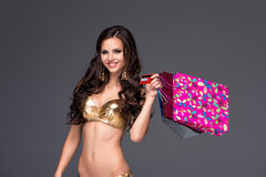 Young woman with shopping bags and credit card on Stock Photo
