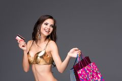Young woman with shopping bags and credit card on Stock Image
