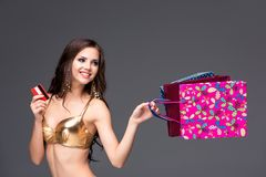 Young woman with shopping bags and credit card on Stock Photography