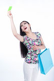 Young woman with shopping bags and credit card on a white backgr Royalty Free Stock Photo