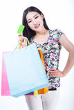 Young woman with shopping bags and credit card on a white backgr Royalty Free Stock Image