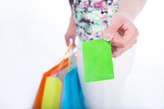 Young woman with shopping bags and credit card on a white backgr Royalty Free Stock Images